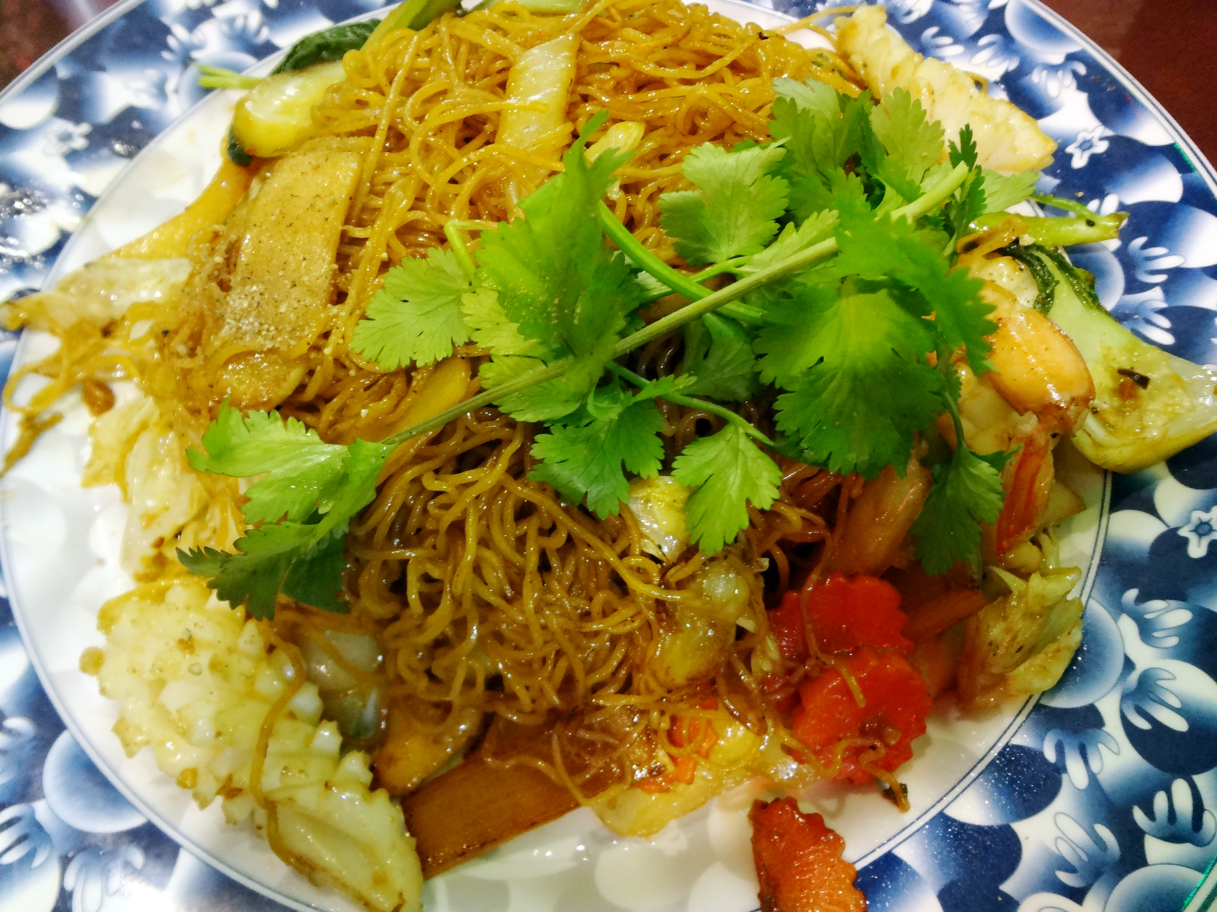 Mi Xao Mem Thap Cam - soft egg noodles stir-fried with sauteed seafood and mixed vegetables
