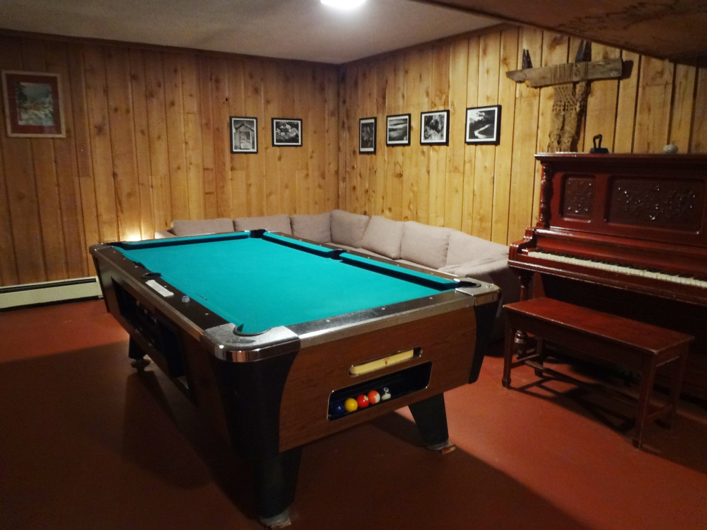 The slighly dilapidated basement pool table