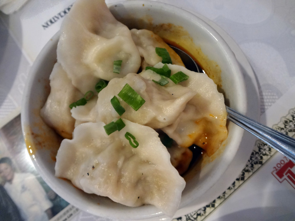 Steamed dumplings in spicy sauce.