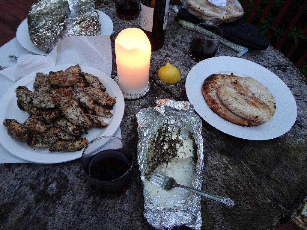 Candlelit meal on a tree stump table