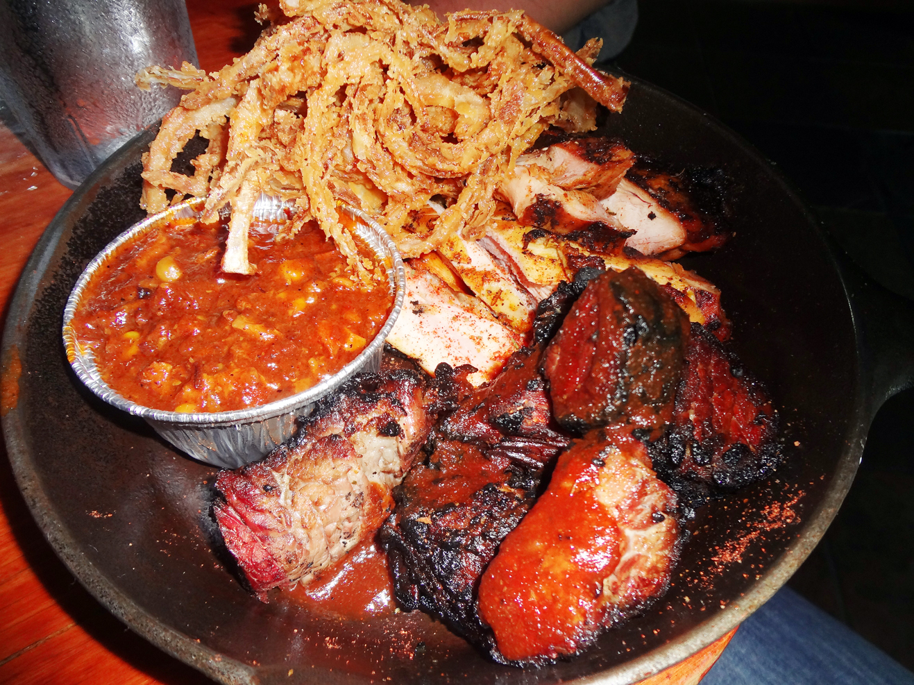 Two-meat plate: burnt ends and char-smoked chicken with onion hay and Brunswick stew