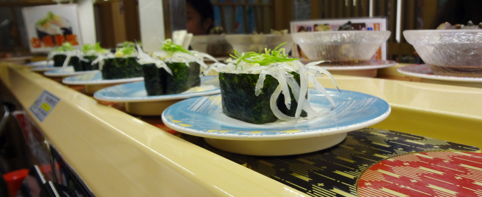 Baby herring sushi on the conveyor belt
