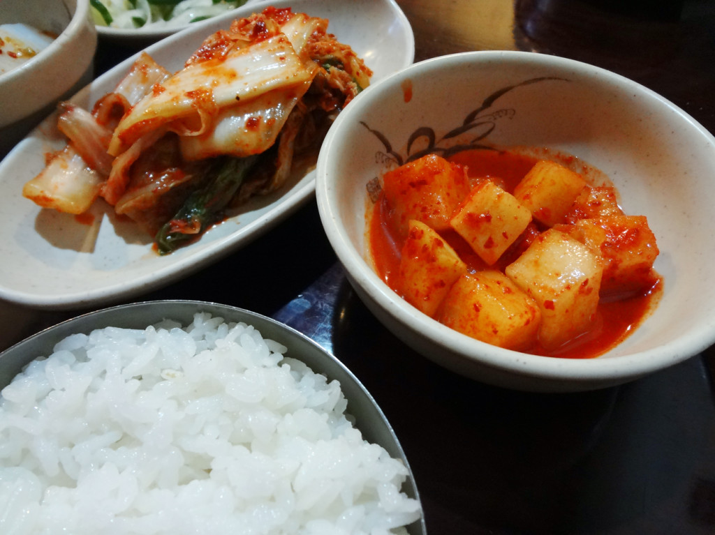 More banchan: cabbage kimchi, kkakdugi, and rice