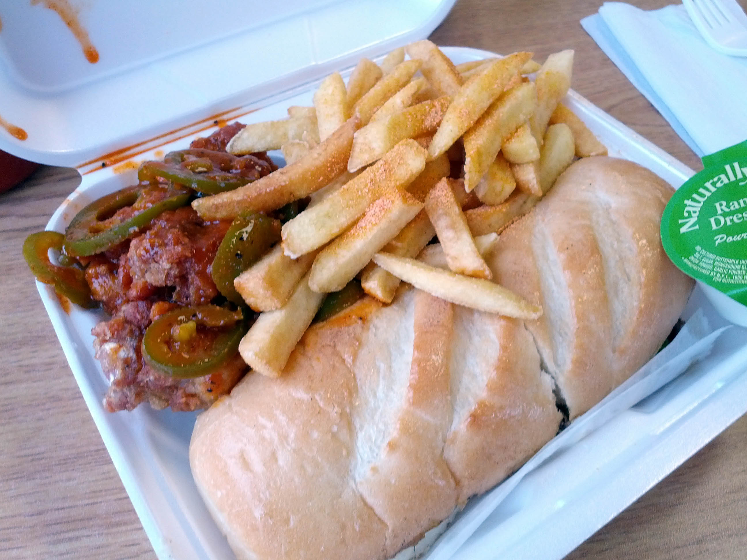 Philly cheesesteak, mexican hot wings, and fries