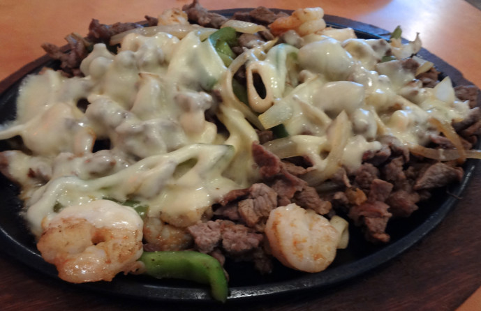 El Maremoto: grilled shrimp, steak, octopus, and squid with bell peppers, onions, and cheese.