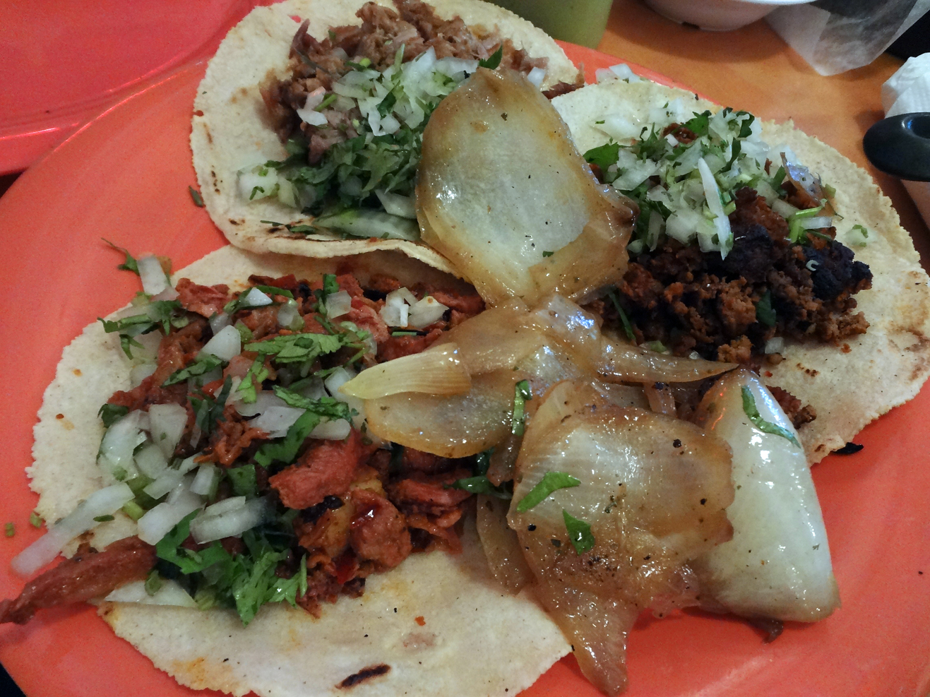 Tacos: chorizo, carnitas, and carne asada