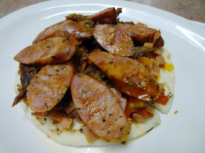 Arepa with carnitas, ham and chorizo