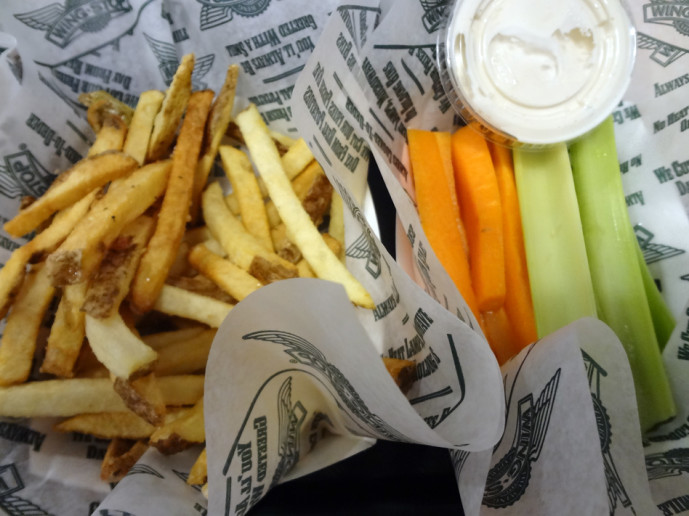 Wing Stop seasoned fries, and veggie sticks with dip