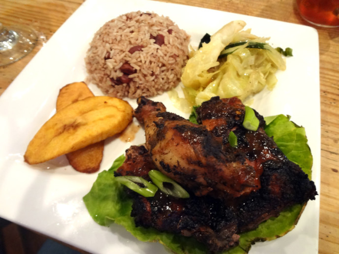 Jerk chicken lunch plate with chopsuey, rice and peas, and plantains.