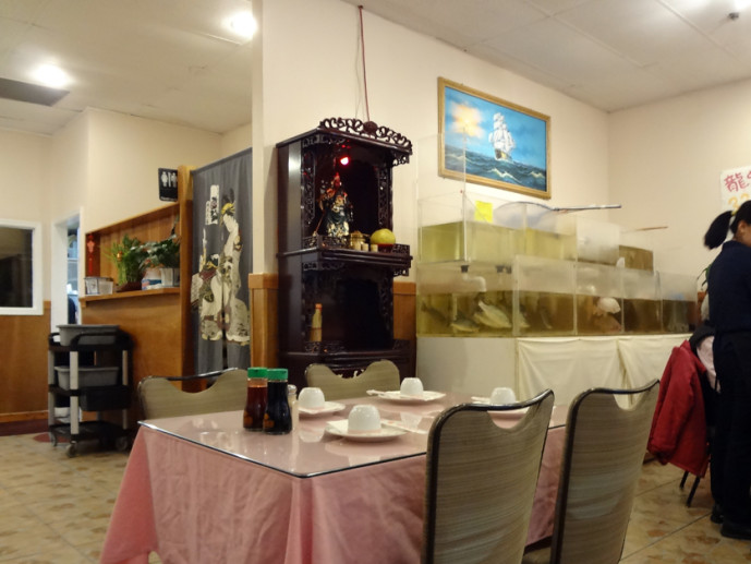 Golden BBQ altar and live fish